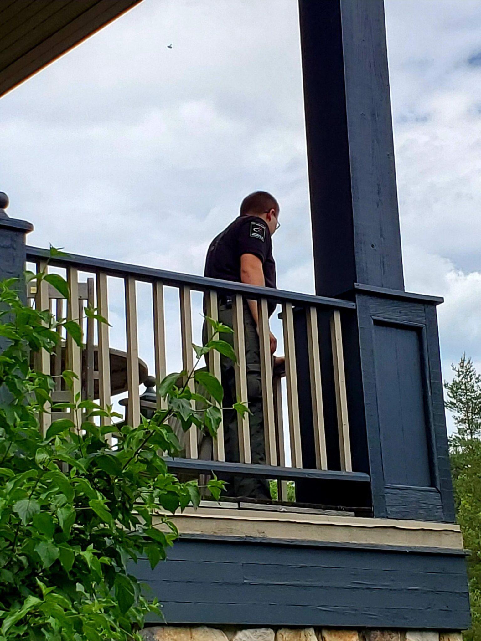 Man On Balcony