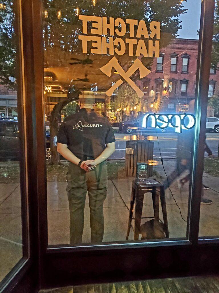 Man Protecting Storefront